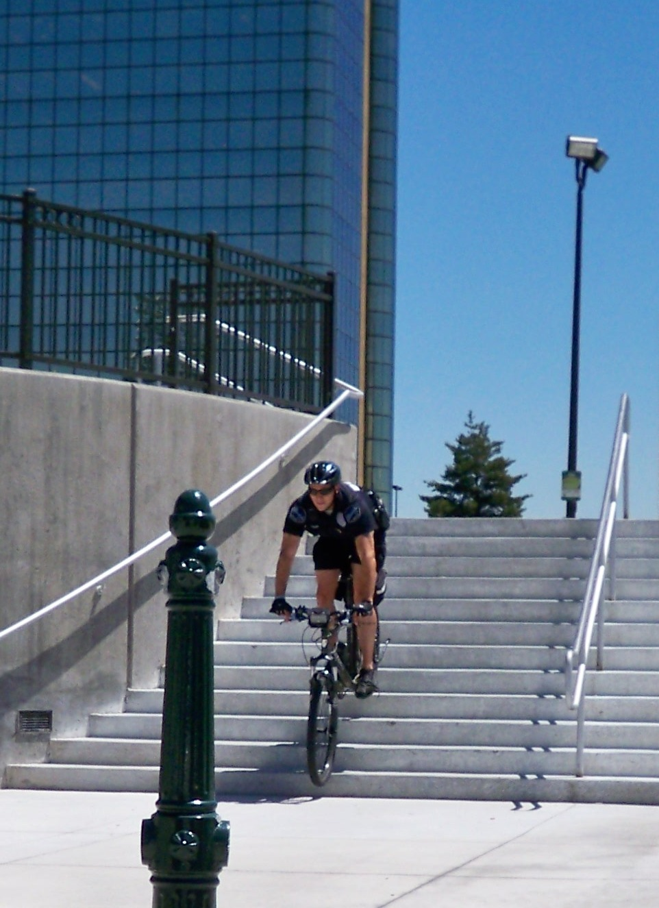 officer going down stairs on bike